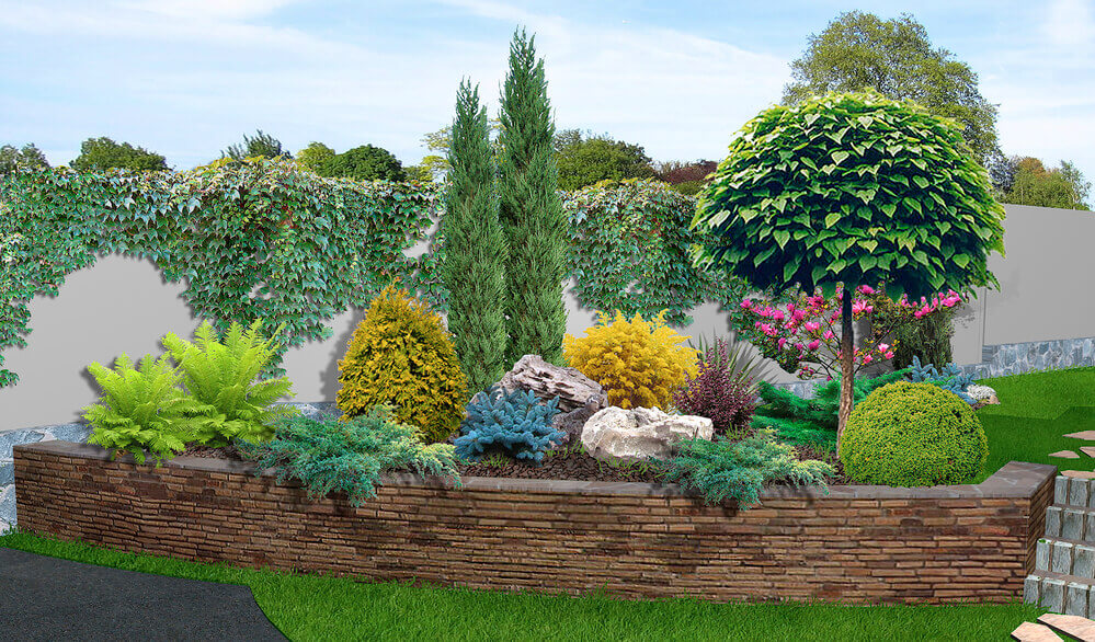 a thin stone retaining wall with a garden bed inside it